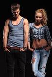 Varma par som poserar på studiobakgrund Fotografering för Bildbyråer