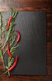Varma peppar och rosmarin arkivbild