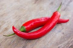 Varma röda chili- eller chilipeppar Arkivfoto