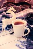 Varma te och julhjortar Arkivfoto