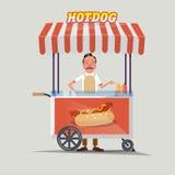 Varmkorvvagn med säljaren - Royaltyfri Foto