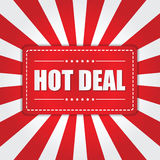 Varmt avtalsbaner med sunbursteffekt på vit och röd bakgrund Fotografering för Bildbyråer