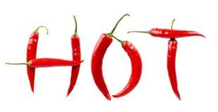 Varmt för inskrift som gjordes från peppar för den röda chili, isolerade vit Royaltyfria Bilder