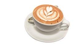 Varmt Mocca kaffe med lattekonst i folwerform Arkivbilder