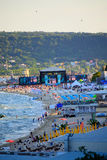 Varna beach MTV concert scene. The scene and audience on Varna beach just before the start of  MTV party.For the first time, MTV came to Bulgaria to produce an Stock Images