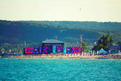 Varna beach MTV concert scene. The scene and audience on Varna beach just before the start of  MTV party.For the first time, MTV came to Bulgaria to produce an Stock Photos
