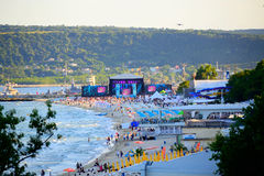 Varna beach MTV live concert scene. The scene and audience on Varna beach just before the start of  MTV party.For the first time, MTV came to Bulgaria to produce Royalty Free Stock Photos