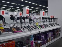 Counter with hairdryers and curling irons of different manufacturers in a Technomarket store in Varna stock photography