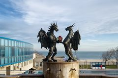 Modern sculpture `The Dragons in Love` on a stone pedestal by the artist Darin Lazarov in Varna. Varna, Bulgaria, December 22, 2018. Modern sculpture `The stock photography