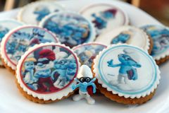 Smurf design gingerbread iced cookies. VARNA, BULGARIA DECEMBER 9, 2017: Pile of homemade Smurf design gingerbread iced cookies on a white plate with the focus Royalty Free Stock Photo