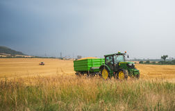 Varna, Bulgaria - June 20, 2015: Tractor in the field Stock Images