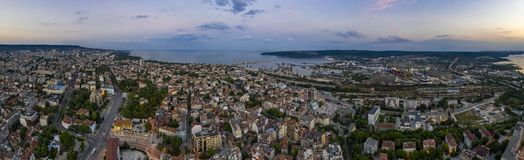 Amazing detail aerial panorama of city, bay and lake at sunset stock photography