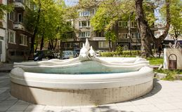 VARNA, BULGARIA - MAY 02, 2017: Fountain with dophins near St. Nicolas church on boulevard knyaz Boris I, Varna stock image