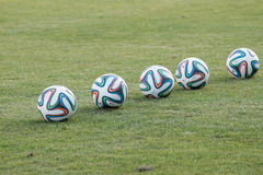 Varna, BULGARIA - MAY 30, 2015: 5 official FIFA 2014 World Cup balsl (Brazuca) on the grass. Royalty Free Stock Image