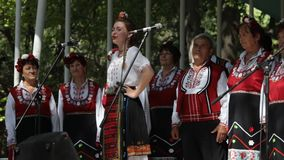 Bulgarian folklore singers. Varna, Bulgaria - September 6, 2016: Folklore group singing during the regional folklore festival Songs On The Shore. The festival is stock footage
