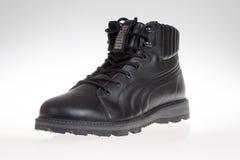 Varna , Bulgaria - SEPTEMBER 26, 2014: PUMA winter leather men shoe. Puma, a major German company.Product shot Royalty Free Stock Images