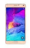 Varna, Bulgaria-Studio shot of a gold Samsung Galaxy Note 4 smartphone Royalty Free Stock Photography