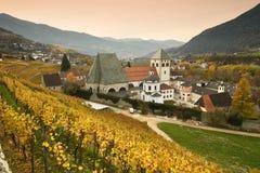 Novacella Monastery with vineyards during autumn season. Located in Varna, Bolzano, Trentino Alto-Adige, Italy. Varna BZ 2 November 2017: Novacella Monastery royalty free stock photos