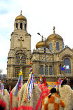 Varna Carnival mummers and Cathedral Royalty Free Stock Image