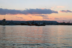 Varna harbor with cargo docks after sunset Stock Images
