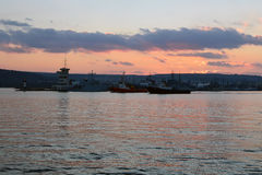 Varna harbor with cargo docks after sunset Stock Photography