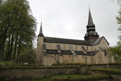 Varnhem Monastery Sweden. A picture of Varnhem Monastery in Sweden on an overcast day with a view of the steeples and the façade of building, trees and ruins stock images