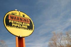 varning för oljapipelinetecken Royaltyfria Bilder