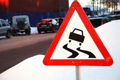 Varning sign for slippery road ahead Royalty Free Stock Photography