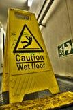 Varning! vått golv Arkivbilder