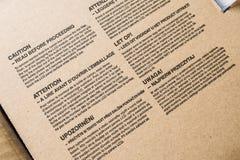 Varningsanmärkningar på den elektroniska apparaten Arkivbilder