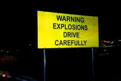 Varningsexplosioner kör försiktigt Fotografering för Bildbyråer