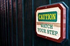 Varningsklocka ditt momenttecken arkivfoton