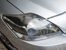 Varnish coating is peeling from the headlight. Varnish coating is peeling from the headlight of the old city car Stock Photography