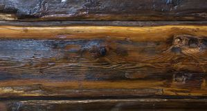 The varnished dark brown wood oak, background Royalty Free Stock Image
