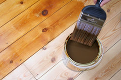 Varnished Floor 2. Close-up of someone varnishing a wooden floor royalty free stock photo
