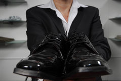 Varnished shoes. Man in business suit with varnished shoes in his hands Stock Image