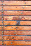 Varnished vintage boarding on the wall, texture material. Royalty Free Stock Photos