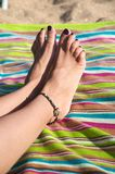 Varnished woman toenails Royalty Free Stock Image