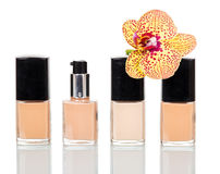 Varnishes for manicure, pedicure and orchid flower isolated on white. Stock Image
