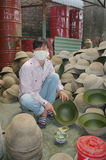 Varnishing the military helmet Stock Images