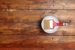 Varnishing old wooden plank floor Stock Images