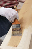 Varnishing a plank Stock Photos