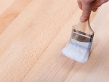 Varnishing of surface of beech table top Stock Photography