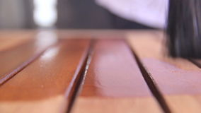 Varnishing Table 5. Close up of a paint brush painting a wooden table with varnish or wood stain stock video footage
