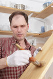 Varnishing wood shelves Stock Images