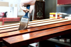 Varnishing wooden boards Stock Photography