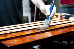 Varnishing wooden boards Stock Photos