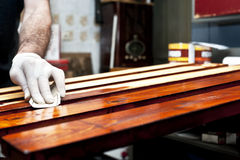 Varnishing wooden boards Stock Photo