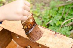 Varnishing wooden box. While varnished wooden box, horizontal photo Stock Images
