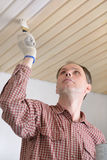 Varnishing a wooden ceiling Stock Photos